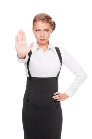 serious businesswoman showing stop gesture  studio shot over white background photo