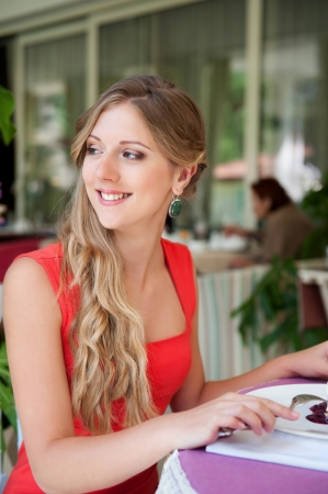 attractive young blonde resting in the cafe photo