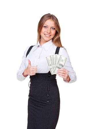 woman holding money: alluring businesswoman holding money and showing thumbs up. studio shot on white background Stock Photo