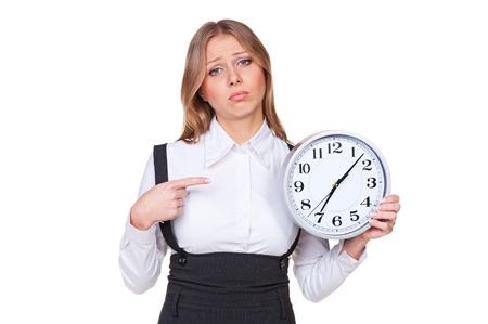 punctual: empresaria triste que señala en el reloj. aislado sobre fondo blanco Foto de archivo