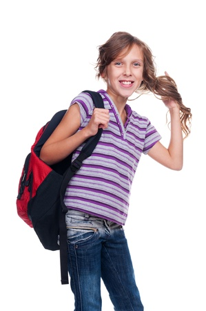 nine years old: excited girl holding rucksack and standing against white background
