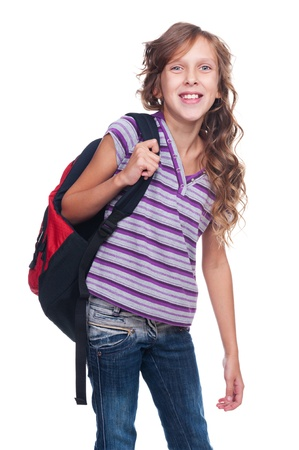 nine years old: excited pupil holding knapsack against white background