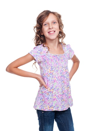nine years old: glad little girl looking at camera and smiling. studio shot over white background