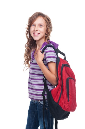 10 year old: smiley girl of about ten holding red rucksack. isolated on white background Stock Photo