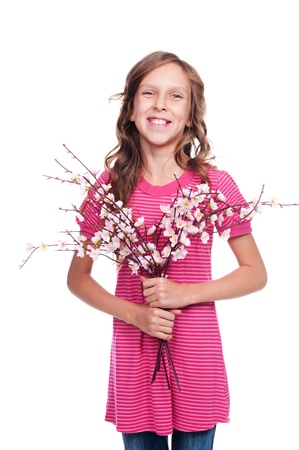 excited pretty girl with spring flowers posing over white background and smiling photo