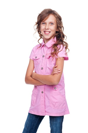 10 year old: smiley little girl with folded hands standing against white background