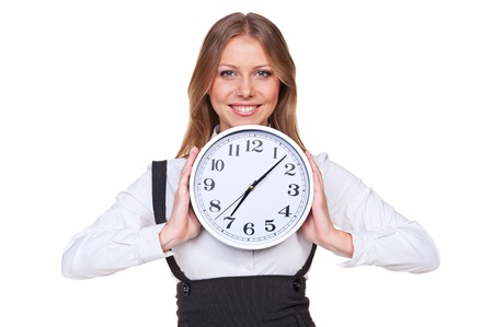 punctual: happy young businesswoman holding the clock and smiling. isolated on white background
