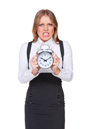 discontented: angry businesswoman holding the clock. studio shot over background Stock Photo