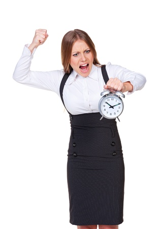 discontented: discontented businesswoman holding the alarm clock. isolated on white background