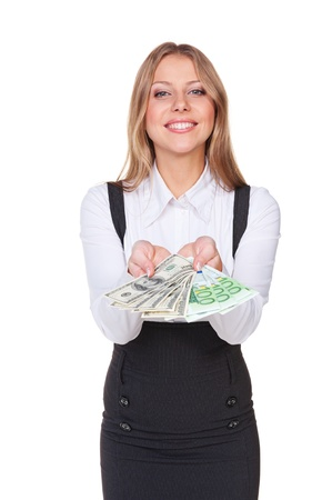 woman holding money: happy businesswoman with money. studio shot over white background