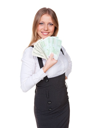 woman holding money: successful young businesswoman holding paper money and smiling. isolated on white background
