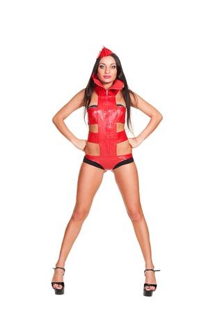 gogo girl: studio shot von sexy Go-go-Tänzerin im roten Bühnenkostüm. isoliert auf weißem Hintergrund Lizenzfreie Bilder