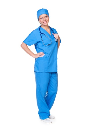 cheerful female in medical uniform with stethoscope standing against white background Stock Photo - 16536302