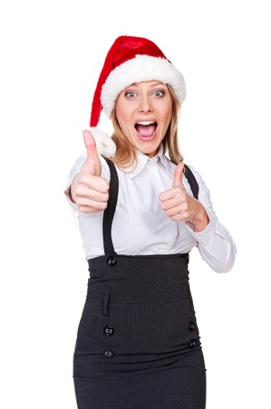 thumbs up woman: laughing and happy businesswoman showing thumbs up. christmas theme Stock Photo