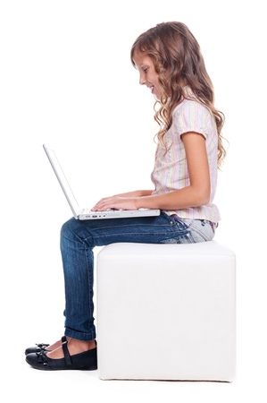 year profile: sideview of smiley girl with laptop. full length photo over white background
