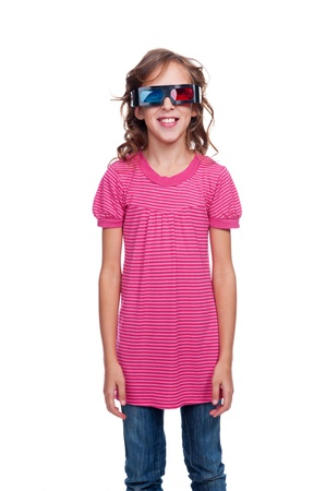 child standing: studio shot of ten year girl in stereo glasses. isolated on white background