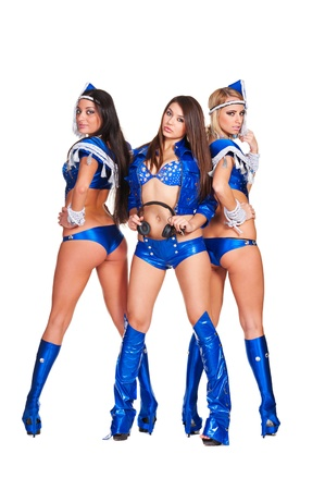 sexy headphones: three beautiful go-go dancers in blue stage costumes isolated on white