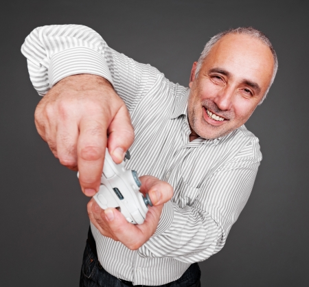jovial man oncentrated on gaming. studio shot over grey background Stock Photo - 16790330
