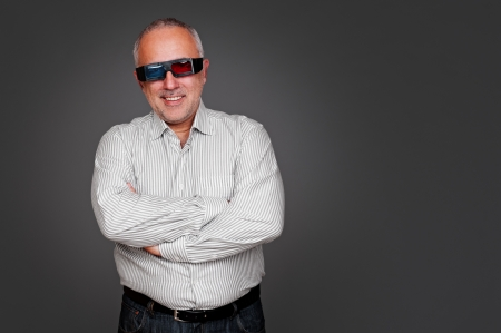 portrait of senior man with 3d glasses standing near empty copyspace Stock Photo - 16790350