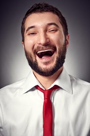 portrait of joyful man over dark background Stock Photo - 17377089