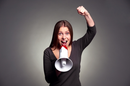 emotional young woman screaming in loudspeaker Stock Photo - 17424917