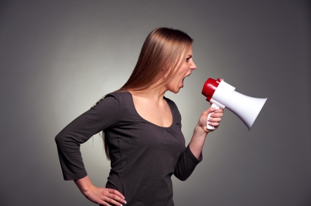 emotional young woman shouting in loudspeaker Stock Photo - 17424903