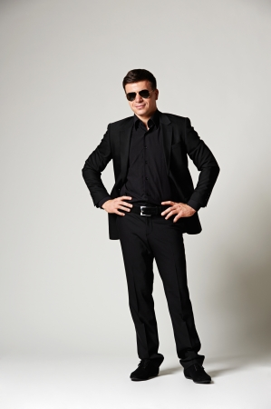 assured: assured stylish man in black formal wear Stock Photo