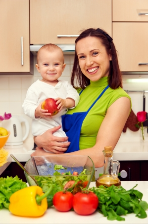 smiley mother and her son at the kitchen photo