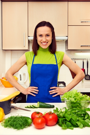 happy young woman in kitchen photo