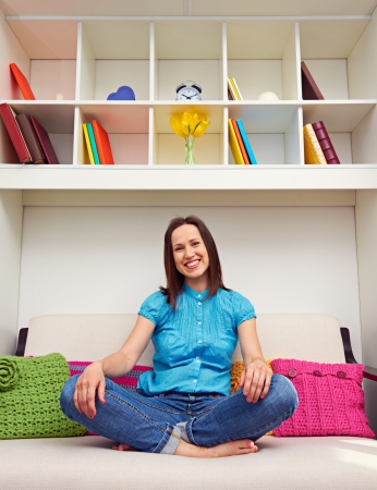smiley woman sitting on the sofa and looking at camera Stock Photo - 18351849