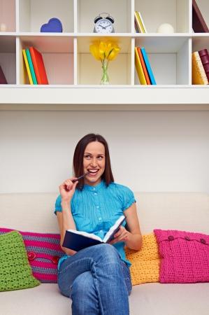 joyous: joyous young woman inventing something Stock Photo