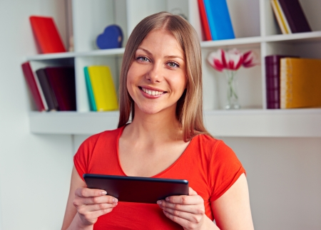 joyous young woman holding the tablet pc and looking at camera Stock Photo - 18520131