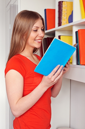 smiley young woman reading a novel Stock Photo - 18520129