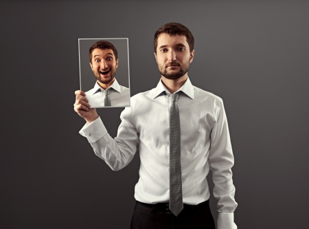 serious and calm businessman hiding his gladness Stock Photo - 18635348