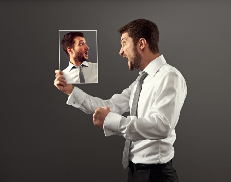 reproach: young man have a conflict with himself Stock Photo