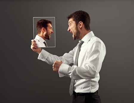 strife: worry man have a hot discussion with himself Stock Photo