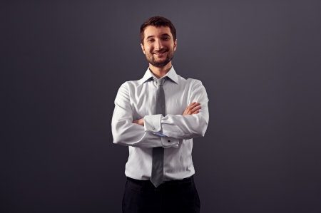 portrait of satisfied businessman over dark background Stock Photo - 18635390