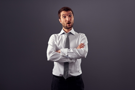 discredit: portrait of surprised businessman over grey background Stock Photo