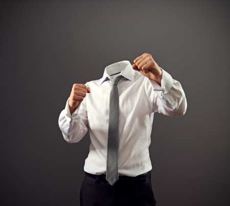 malice: invisible businessman stooding in a fighting stance. concept photo Stock Photo