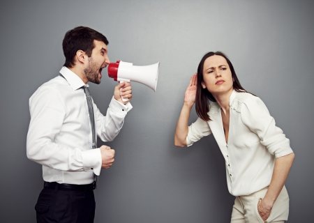 woman shouting: young businesswoman listening her angry boss Stock Photo