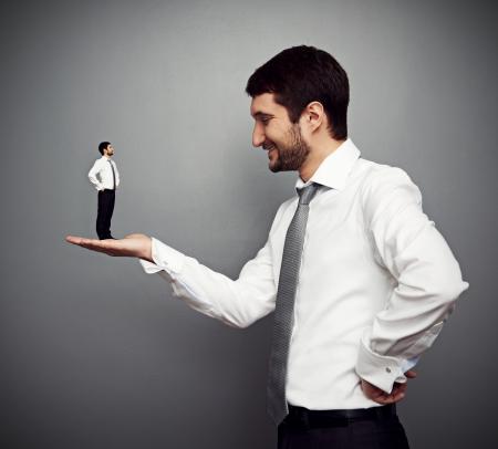 subordinate: concept photo of big boss and small subordinate Stock Photo