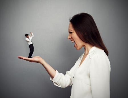 subordinate: concept photo of big boss screaming at the small subordinate