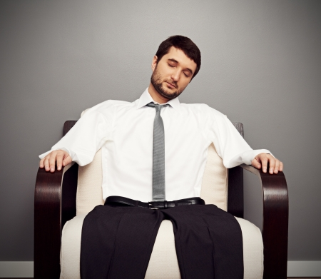 fatigued: concept photo of fatigued businessman on the armchair