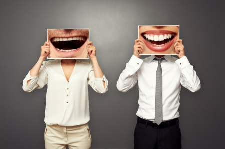 stomatologist: man and woman changed their smiles. concept photo