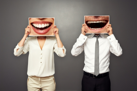 merriment: concept photo of laughing merrily couple over dark background Stock Photo