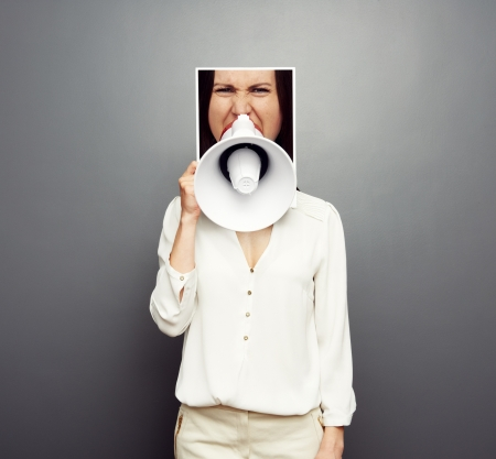 concept photo of young female screaming in megaphone over dark background Stock Photo - 19377955