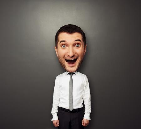 big head: funny picture of bighead happy man in white shirt and tie over dark background