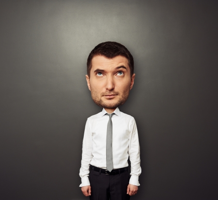 big head: funny picture of bighead man in white shirt and tie over dark background