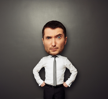big head: funny picture of businessman with big head over dark background