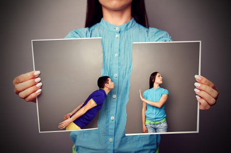 lacerated: woman holding the lacerated photo of young couple in quarrel